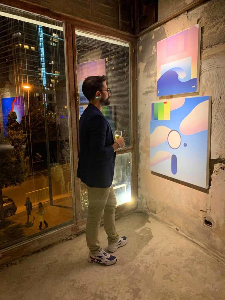 Georges Abou Chabke looking at contemporary modern art in an exhibition in Beirut Lebanon