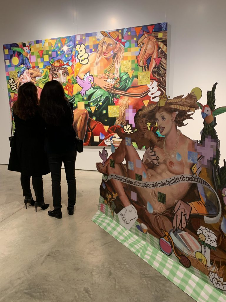 women at an art exhibition in beirut watching contemporary modern paintings by american artist